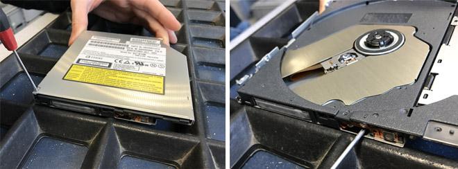 Das neue Laufwerk wird geöffnet indem die drei Schrauben am Gehäuse gelöst, die obere Abdeckung entfernt und das Laufwerk manuell entriegelt wird.